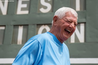 """Former Boston Red Sox left fielder Carl Yastrzemski laughs in front of the Green Monster scoreboard during a Genesis Fund event at Fenway Park in Boston, Massachusetts Thursday, June 18, 2015."""