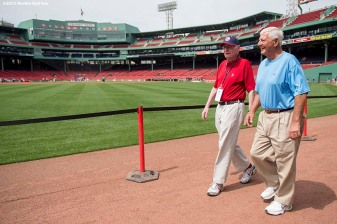 """Former Boston Red Sox left fielder Carl Yastrzemski walks with Poet Laureate Dick Flavin during a Genesis Fund event at Fenway Park in Boston, Massachusetts Thursday, June 18, 2015."""