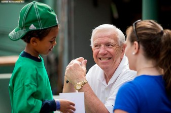 """""""Former Boston Red Sox catcher Bob Montgomery greets a young fan during a Genesis Fund event at Fenway Park in Boston, Massachusetts Thursday, June 18, 2015."""""""