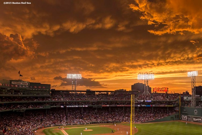 """""""The sun sets over Fenway Park during a game between the Boston Red Sox and the Baltimore Orioles at Fenway Park in Boston, Massachusetts Tuesday, June 23, 2015."""""""