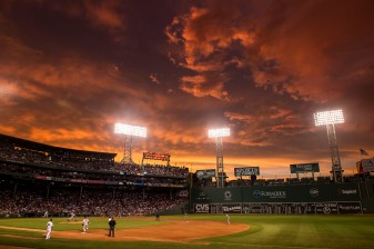 """The sun sets over Fenway Park during a game between the Boston Red Sox and the Baltimore Orioles at Fenway Park in Boston, Massachusetts Tuesday, June 23, 2015."""