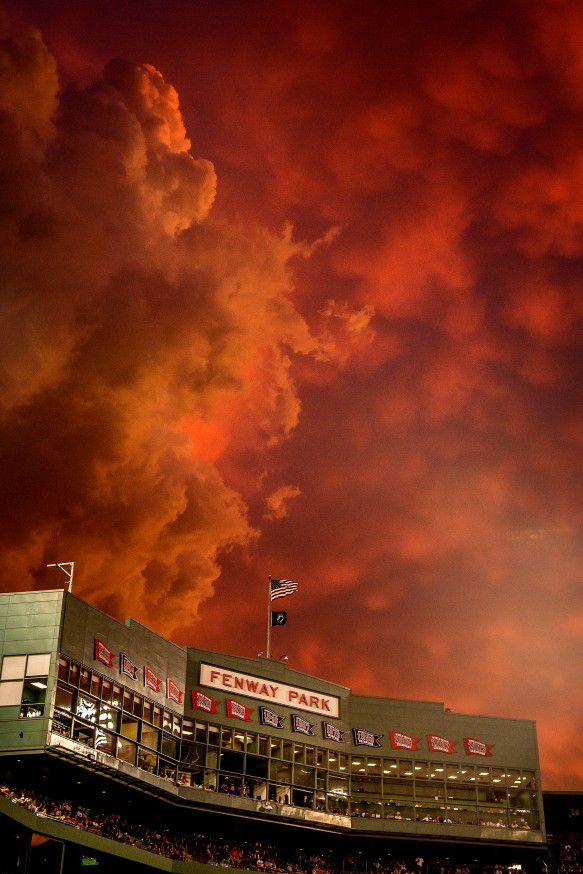 June 23, 2015, Boston, MA: The sun sets over Fenway Park during a game between the Boston Red Sox and the Baltimore Orioles at Fenway Park in Boston, Massachusetts Tuesday, June 23, 2015. (Photos by Billie Weiss/Boston Red Sox)