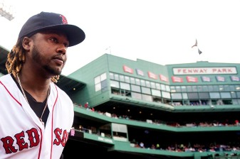 """""""Right fielder Hanley Ramirez runs onto the field before a game between the Boston Red Sox and the Baltimore Orioles at Fenway Park in Boston, Massachusetts Tuesday, June 23, 2015."""""""