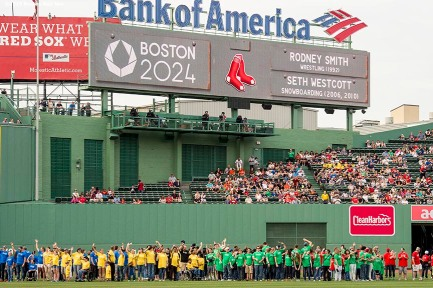 """""""Olympian hopefuls are introduced in centerfielder during a Boston 2024 Olympic Games ceremony before a game between the Boston Red Sox and the Baltimore Orioles at Fenway Park in Boston, Massachusetts Tuesday, June 23, 2015."""""""