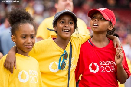 """""""Young fans look on during a Boston 2024 Olympic Games ceremony before a game between the Boston Red Sox and the Baltimore Orioles at Fenway Park in Boston, Massachusetts Tuesday, June 23, 2015."""""""