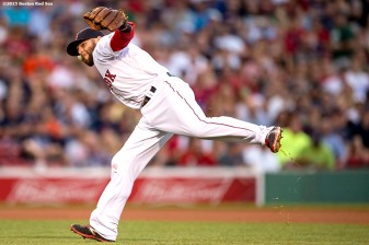 """""""Boston Red Sox second baseman Dustin Pedroia throws to first base during the fourth inning of a game against the Baltimore Orioles at Fenway Park in Boston, Massachusetts Wednesday, June 24, 2015."""""""