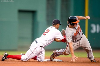 """Boston Red Sox shortstop Xander Bogaerts applies a tag during the fourth inning of a game against the Baltimore Orioles at Fenway Park in Boston, Massachusetts Wednesday, June 24, 2015."""