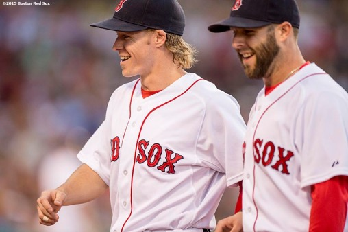 """""""Boston Red Sox first baseman Brock Holt and second baseman Dustin Pedroia react during the fourth inning of a game against the Baltimore Orioles at Fenway Park in Boston, Massachusetts Wednesday, June 24, 2015."""""""