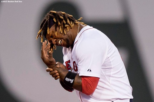 """""""Boston Red Sox left fielder Hanley Ramirez reacts after being hit with a line drive during the fifth inning of a game against the Baltimore Orioles at Fenway Park in Boston, Massachusetts Wednesday, June 24, 2015."""""""