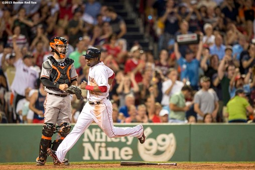 """Boston Red Sox right fielder Alejandro De Aza scores during the sixth inning of a game against the Baltimore Orioles at Fenway Park in Boston, Massachusetts Wednesday, June 24, 2015."""