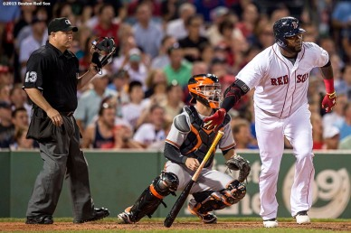 """""""Boston Red Sox designated hitter David Ortiz hits a two-run home run during the sixth inning of a game against the Baltimore Orioles at Fenway Park in Boston, Massachusetts Wednesday, June 24, 2015."""""""