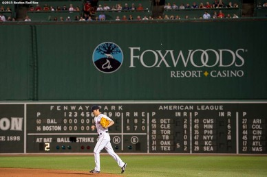 """""""Boston Red Sox pitcher Koji Uehara enters the game during the ninth inning of a game against the Baltimore Orioles at Fenway Park in Boston, Massachusetts Wednesday, June 24, 2015."""""""