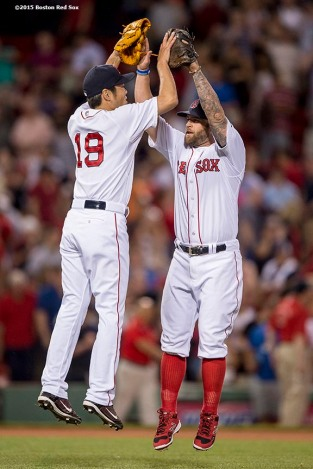 """""""Boston Red Sox pitcher Koji Uehara and first baseman Mike Napoli high five after a game against the Baltimore Orioles at Fenway Park in Boston, Massachusetts Wednesday, June 24, 2015."""""""