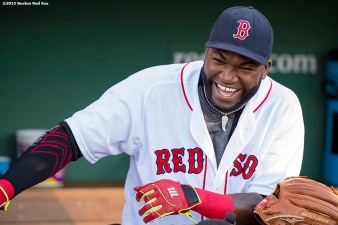 """Boston Red Sox designated hitter David Ortiz laughs before a game against the Baltimore Orioles at Fenway Park in Boston, Massachusetts Wednesday, June 24, 2015."""