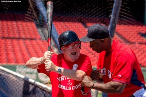 """Boston Red Sox hitting coach Chili Davis gives pointers to a Veteran during a CVS Hitting Clinic at Fenway Park in Boston, Massachusetts Friday, July 3, 2015."""
