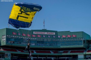 """A Navy Seals parachutes toward the field during a trial run before a pre-game ceremony during a CVS Hitting Clinic at Fenway Park in Boston, Massachusetts Friday, July 3, 2015."""