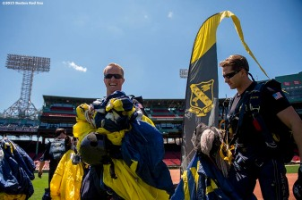 """Navy Seals react after parachuting toward the field during a trial run before a pre-game ceremony during a CVS Hitting Clinic at Fenway Park in Boston, Massachusetts Friday, July 3, 2015."""