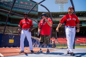 """A veteran takes batting practice with Boston Red Sox hitting coach Chili Davis and assistant hitting coach Victor Rodriguez during a CVS Hitting Clinic at Fenway Park in Boston, Massachusetts Friday, July 3, 2015."""