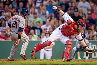 """Boston Red Sox catcher Ryan Hanigan reaches for an overthrown ball as first baseman Jon Singleton scores during the third inning of a game against the Houston Astros at Fenway Park in Boston, Massachusetts Friday, July 3, 2015."""