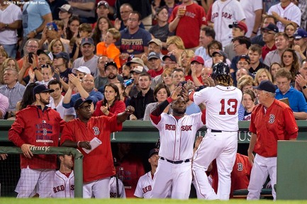"""""""Boston Red Sox left fielder Hanley Ramirez high fives designated hitter David Ortiz after scoring during the fifth inning of a game against the Houston Astros at Fenway Park in Boston, Massachusetts Friday, July 3, 2015."""""""