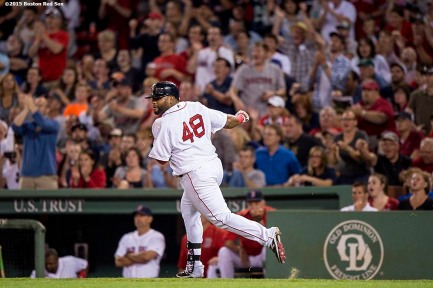 """Boston Red Sox third baseman Pablo Sandoval reacts after hitting an RBI single during the seventh inning of a game against the Houston Astros at Fenway Park in Boston, Massachusetts Friday, July 3, 2015."""