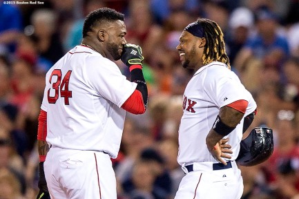 """Boston Red Sox designated hitter David Ortiz laughs with left fielder Hanley Ramirez during the seventh inning of a game against the Houston Astros at Fenway Park in Boston, Massachusetts Friday, July 3, 2015."""