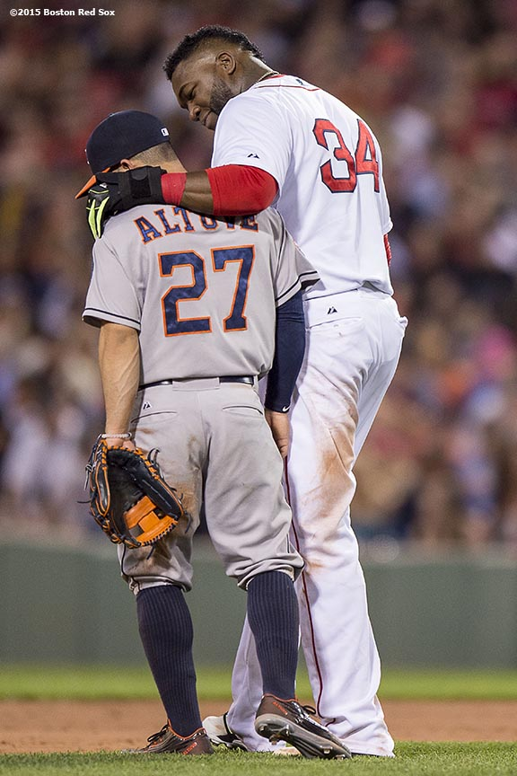 """Boston Red Sox designated hitter David Ortiz talks with Jose Altuve during the seventh inning of a game against the Houston Astros at Fenway Park in Boston, Massachusetts Friday, July 3, 2015."""