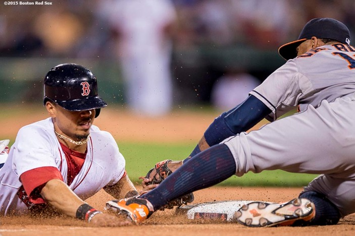 """Boston Red Sox center fielder Mookie Betts is tagged out as he slides into third base during the eighth inning of a game against the Houston Astros at Fenway Park in Boston, Massachusetts Friday, July 3, 2015."""