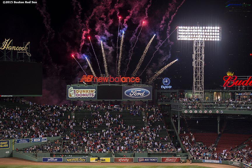 """Fireworks explode over Fenway Park following a game between the Boston Red Sox and the Houston Astros at Fenway Park in Boston, Massachusetts Friday, July 3, 2015."""