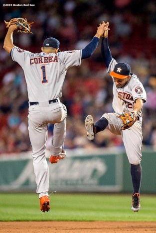 """Houston Astros Carlos Correa and Jose Altuve react after defeating the Boston Red Sox at Fenway Park in Boston, Massachusetts Friday, July 3, 2015."""
