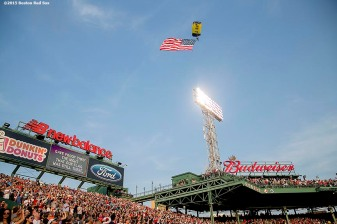 """""""A member of the US Navy SEAL leapfrog team parachutes into Fenway Park with an American Flag before a game between the Boston Red Sox and the Houston Astros at Fenway Park in Boston, Massachusetts Friday, July 3, 2015."""""""