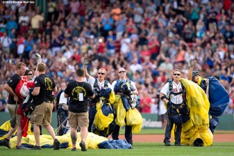 """""""Members of the US Navy SEALS Leapfrogs wave to fans after parachuting into Fenway Park before a game between the Boston Red Sox and the Houston Astros at Fenway Park in Boston, Massachusetts Friday, July 3, 2015."""""""