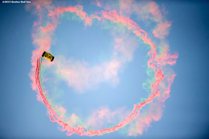 """""""A US Navy SEALS sprays smoke as he parachutes into Fenway Park before a game between the Boston Red Sox and the Houston Astros at Fenway Park in Boston, Massachusetts Friday, July 3, 2015."""""""