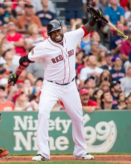"""""""Boston Red Sox designated hitter David Ortiz throws his bat after popping out during the first inning of a game against the Houston Astros at Fenway Park in Boston, Massachusetts Saturday, July 4, 2015."""""""