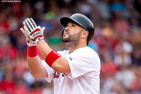 """""""Boston Red Sox catcher Sandy Leon reacts after hitting a single during the second inning of a game against the Houston Astros at Fenway Park in Boston, Massachusetts Saturday, July 4, 2015."""""""
