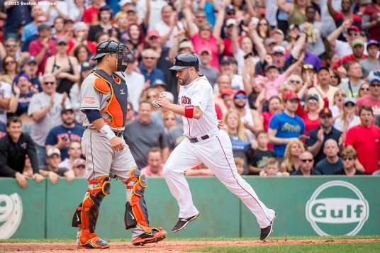 """""""Boston Red Sox catcher Sandy Leon scores during the sixth inning of a game against the Houston Astros at Fenway Park in Boston, Massachusetts Saturday, July 4, 2015."""""""