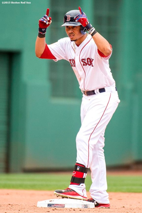"""""""Boston Red Sox center fielder Mookie Betts reacts after hitting an RBI double during the sixth inning of a game against the Houston Astros at Fenway Park in Boston, Massachusetts Saturday, July 4, 2015."""""""