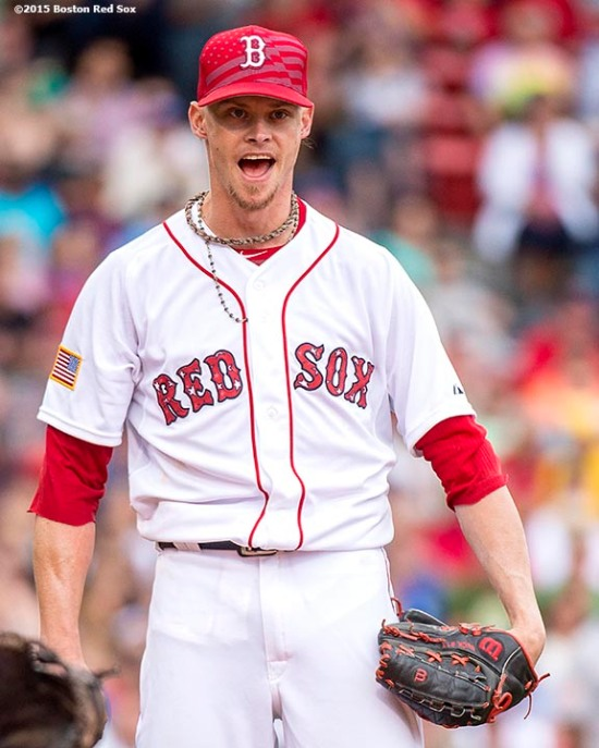 """Boston Red Sox pitcher Clay Buchholz reacts after a double play was turned during the seventh inning of a game against the Houston Astros at Fenway Park in Boston, Massachusetts Saturday, July 4, 2015."""