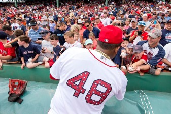 """Third baseman Pablo Sandoval signs autographs before a game between the Boston Red Sox and the Houston Astros at Fenway Park in Boston, Massachusetts Saturday, July 4, 2015."""