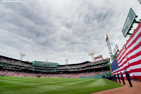 """The American flag is dropped over the Green Monster before a game between the Boston Red Sox and the Houston Astros at Fenway Park in Boston, Massachusetts Saturday, July 4, 2015."""