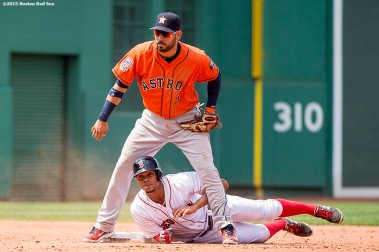 """""""Boston Red Sox shortstop Xander Bogaerts looks on after sliding into second base during the third inning of a game against the Houston Astros at Fenway Park in Boston, Massachusetts Sunday, July 5, 2015."""""""