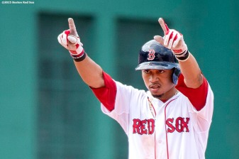 """""""Boston Red Sox center fielder Mookie Betts reacts after hitting a double during the fifth inning of a game against the Houston Astros at Fenway Park in Boston, Massachusetts Sunday, July 5, 2015."""""""