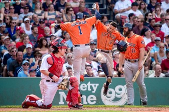 """Houston Astros shortstop Carlos Correa reacts with second baseman Jose Altuve after hitting a two run home run during the seventh inning of a game against the Boston Red Sox at Fenway Park in Boston, Massachusetts Sunday, July 5, 2015."""
