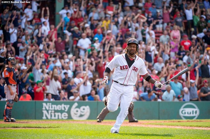 """Boston Red Sox left fielder Hanley Ramirez reacts after hitting a go ahead two run home run during the seventh inning of a game against the Houston Astros at Fenway Park in Boston, Massachusetts Sunday, July 5, 2015."""