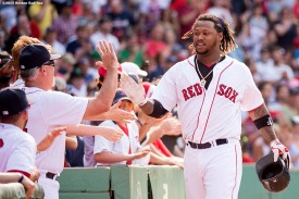 """""""Boston Red Sox left fielder Hanley Ramirez high fives teammates after hitting a go ahead two run home run during the seventh inning of a game against the Houston Astros at Fenway Park in Boston, Massachusetts Sunday, July 5, 2015."""""""