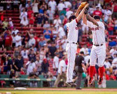 """Boston Red Sox pitcher Koji Uehara and first baseman Mike Napoli high five after defeating the Houston Astros at Fenway Park in Boston, Massachusetts Sunday, July 5, 2015."""