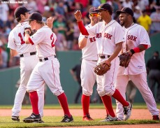 """Boston Red Sox teammates high five each other after defeating the Houston Astros at Fenway Park in Boston, Massachusetts Sunday, July 5, 2015."""