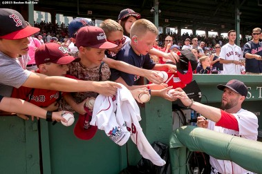 """""""Dustin Pedroia signs autographs before a game between the Boston Red Sox and the Houston Astros at Fenway Park in Boston, Massachusetts Sunday, July 5, 2015."""""""