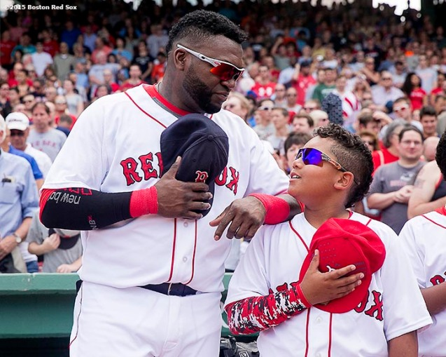 """""""Boston Red Sox designated hitter David Ortiz talks with his son D'Angelo before a game between the Boston Red Sox and the Houston Astros at Fenway Park in Boston, Massachusetts Sunday, July 5, 2015."""""""