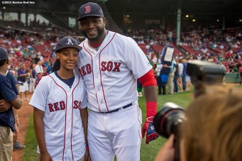 """Designated hitter David Ortiz meets pitcher Mo'ne Davis of the Anderson Monarchs Little League World Series team before a game between the Boston Red Sox and the Houston Astros at Fenway Park in Boston, Massachusetts Tuesday July 7, 2015."""